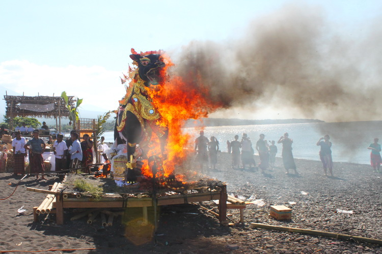 traditional Balinese Cremation Ceremony at Amed beach