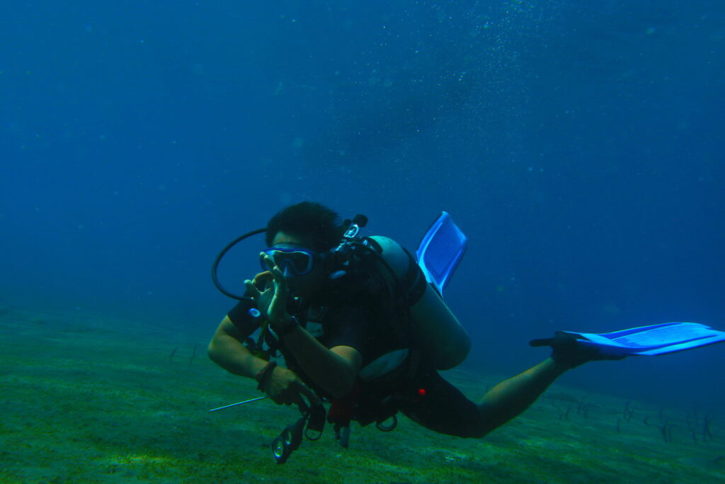 scuba diver at dive course Amed Ghost Bay